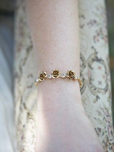 Gold bracelets with flowers