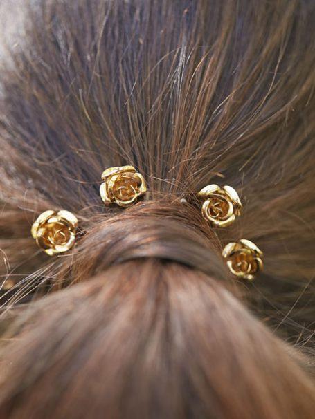 Bride wearing flower hair pins