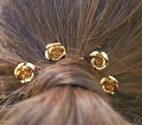 Bride wearing flower hair pins