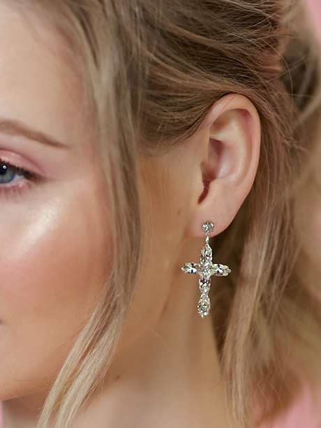 detail of cross earrings