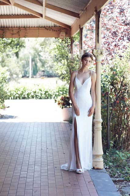 Esparence wedding dress with a split