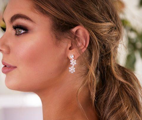 Flower wedding earrings worn by bride