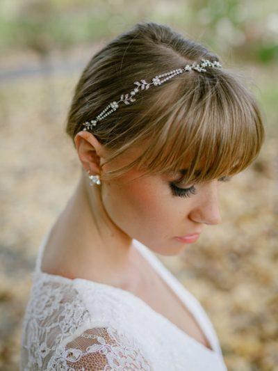 Bride wearing silver wedding headband