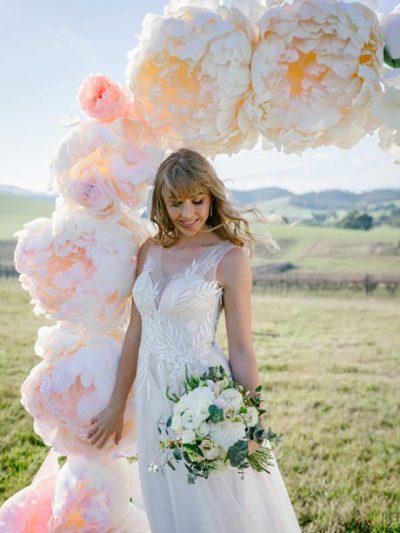 Blush colour beach wedding dress in outdoor setting