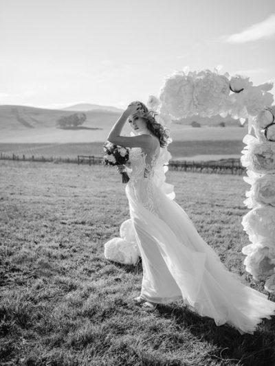 Flowing skirt of the Erica beach wedding dress blowing in the wind