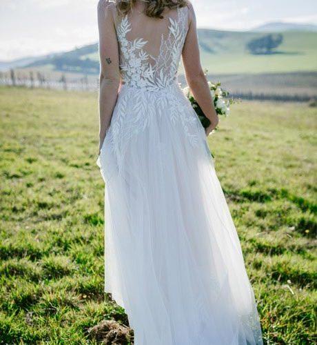 Erica beach wedding dress walking into the sunlight