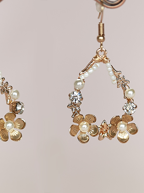 Close up large chandelier earrings