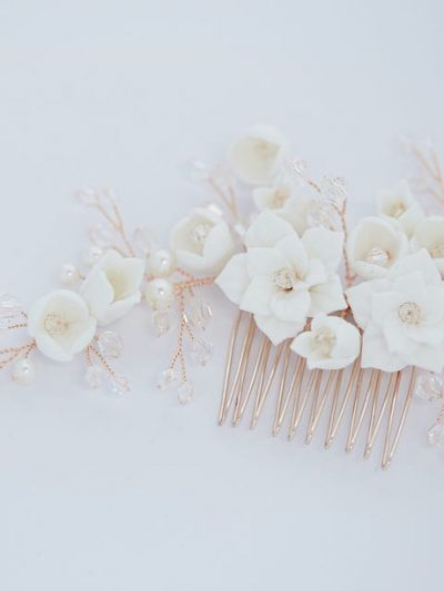 Detail of porcelain flowers in bridal comb