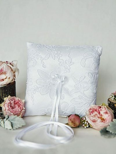 White lace ring cushion for weddings