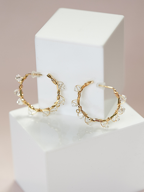Gold jewellery hoops with crystals